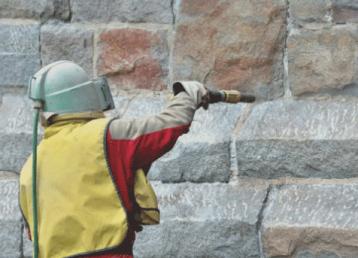 soda-blasting-vancouver washington-concrete-wall-with-suit